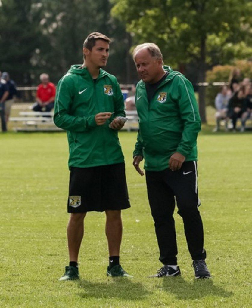 WILDCATS HIT THE ROAD—NMU Womens Soccer Head Coach Jon Sandoval (left) is in his first season after assistant coaching the Mens team under Head Coach David Poggi (right). Sandovals first game as Womens coach will come on the road against Grand Valley State. Photo courtesy of NMU Athletics.