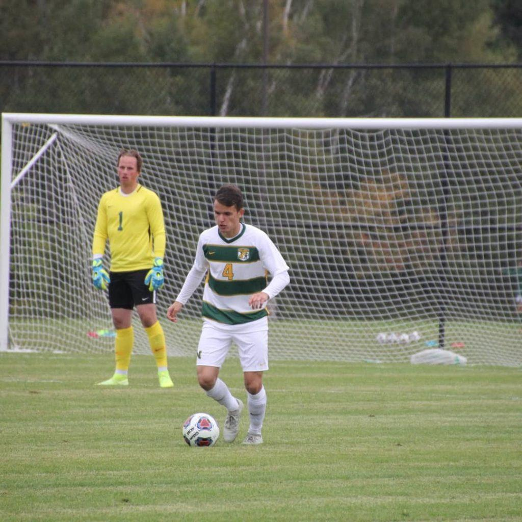 SEASON OPENING LOSS—Junior defender Julius Reis possesses the ball for NMU in a game from last season. In the 2021 season opener, the Cats fell at home to Saginaw Valley State 4-0 inside of the Superior Dome. Photo courtesy of Julius Reis.