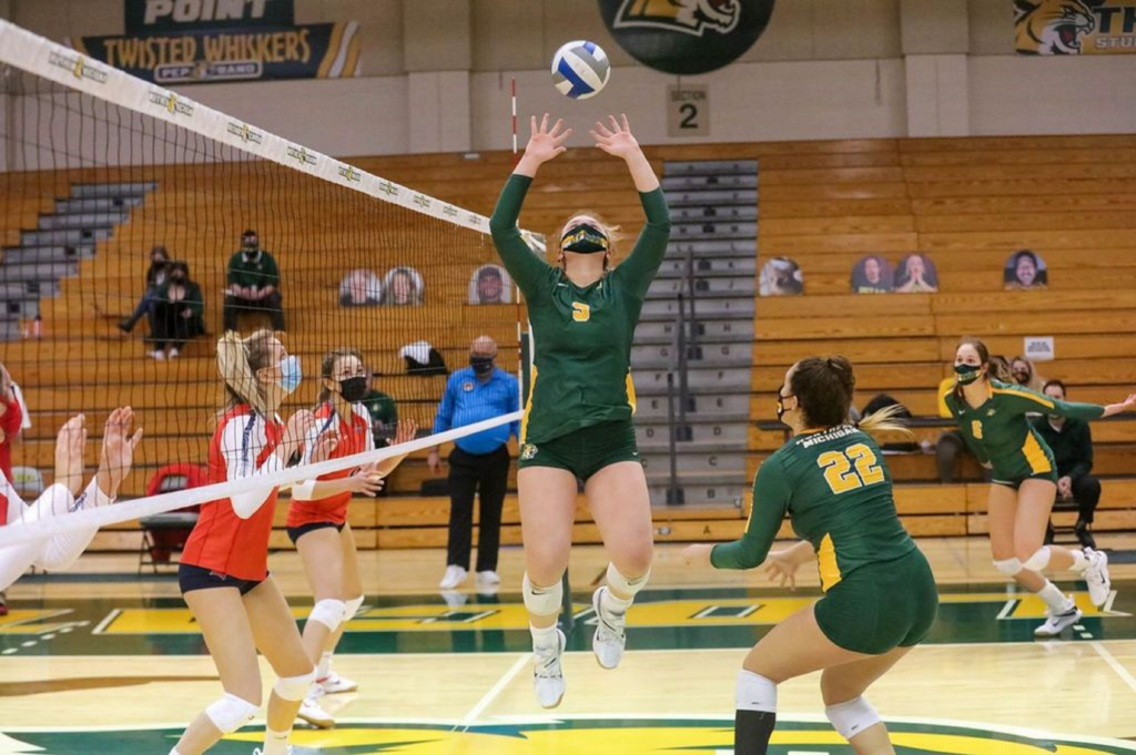 ALL THEY DO IS WIN—Sophomore setter Lauren Van Remortel sets the ball for one of her NMU teammates earlier this season. The NMU Womens Volleyball team is off to a strong start this year, winning seven of their first eight games. Photo courtesy of Lauren Van Remortel.