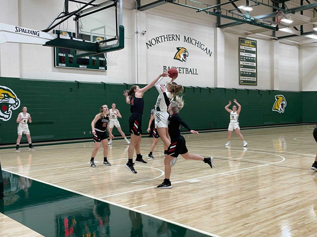 BOWING OUT—NMU sophomore guard Samantha Potter goes up for the contested layup over two Davenport defenders during Tuesday nights game. The NMU Womens Basketball team lost to Davenport in the GLIAC Tournament, ending their season with a final record of 10-9. Dallas Wiertella/NW.