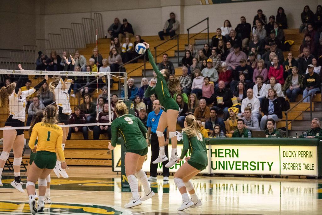 SWEEPING SAGINAW—NMU junior rightside hitter Hailey Wickstrom goes up for the spike during last season when fans were actually allowed in arenas. Her team picked a sweep over Saginaw Valley State this past weekend. Photo courtesy of Hailey Wickstrom.