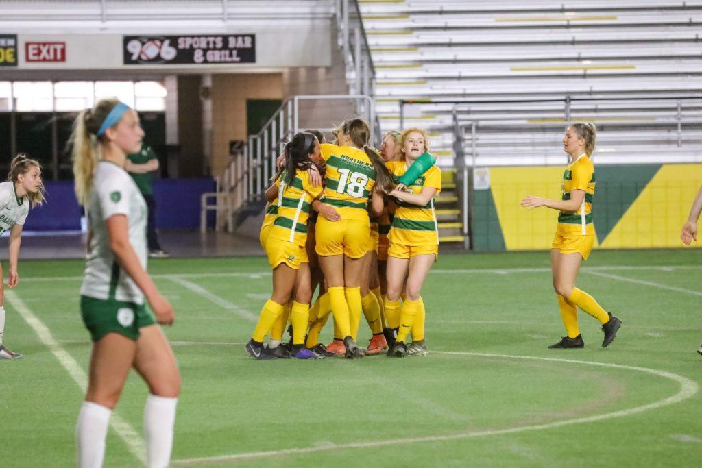 QUITE AN OPENING TEST—The NMU Womens Soccer celebrates a goal. The Cats will have almost two weeks of practice and a scrimmage under their belts when they square off with Division I UWGB in an exhibition match on Friday, Aug. 27. Photo courtesy of NMU Athletics.