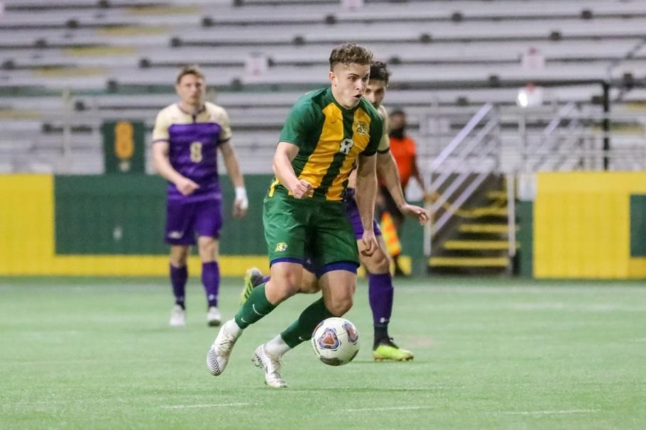 STACKING UP WINS—NMU attacks on offense against Ashland back on Sunday, March 21. The Wildcats have won three straight matches, and have momentum heading into a rivalry showdown with Northwood. Photo courtesy of NMU Athletics.