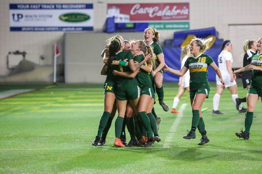 NEARING THE END—The NMU Womens Soccer team celebrates a goal at home in a game earlier this season. The Wildcats look to close out the regular season with a pair of conference home games against Purdue Northwest and Wisconsin-Parkside. Photo courtesy of NMU Athletics.