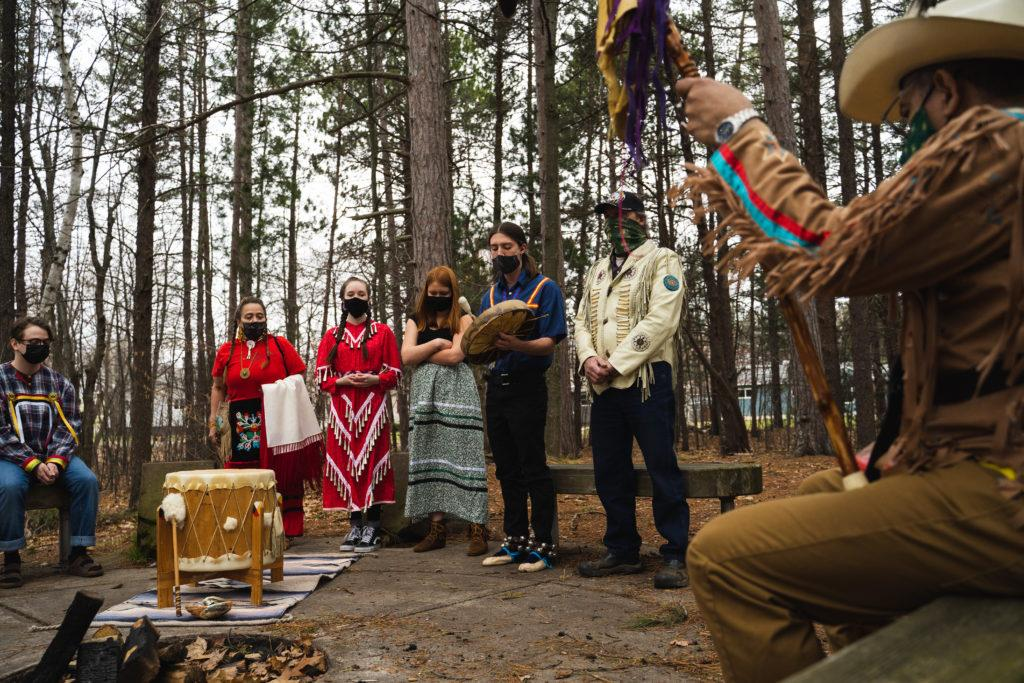 photo+of+Native+American+students+around+a+fire+circle