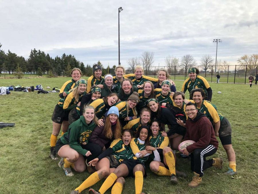 WILDCAT TOUGHNESS—The NMU Womens Rugby team poses for a team picture. The Rugby squad is coming on its first match of the season with the University of Wisconsin-Stout on Saturday, Sept. 18. Photo courtesy of Mandie Kytola.