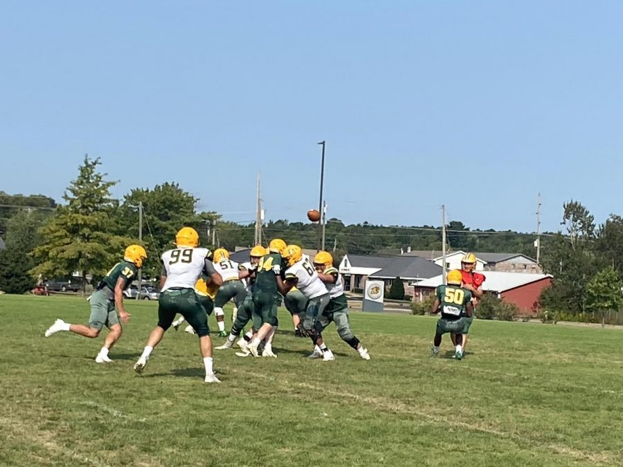 TRAINING CAMP TIME—Quarterback Drake Davis throws a screen pass to tight end Jake Witt at practice on Thursday, Aug. 19. The Wildcats are two weeks out from the season opener against McKendree in what promises to be an important year for the Cats. Travis Nelson/NW