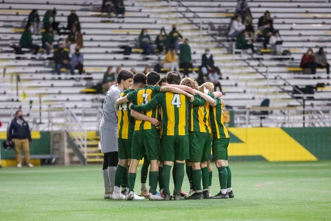 BACK IN ACTION—The NMU Mens Soccer team huddles up together during a game last season. Northern will have its hands full with a loaded GLIAC, but the Wildcats are trying to make history and take home the title. Photo courtesy of NMU Athletics.