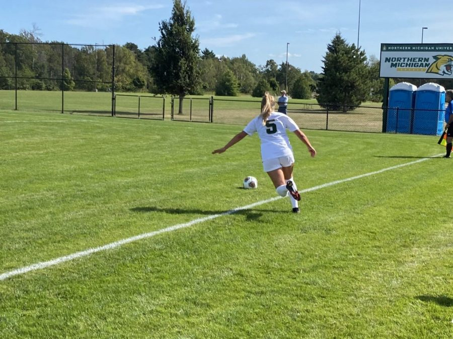 WILDCATS WIN SEASON OPENER—NMU Womens Soccer sophomore midfielder Brooke Pietila goes to kick the ball during NMUs 3-0 shutout victory over St. Cloud State on Thursday afternoon.Travis Nelson/NW