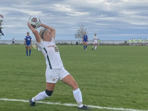 TOUGH OPENER—NMU senior defender Rachael Erste throws the ball in for the Wildcats in Fridays 4-0 loss to Grand Valley State. GVSU is the second-ranked team nationally in Division II, which is a tough way for the Cats to start conference action. Travis Nelson/NW