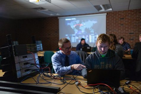 Photo courtesy of Matthew Vogt IN THE LAB—Jim Marquardson, student adviser for information assurance & cyber defense, in the Upper Peninsula Cybersecurity Institute working with a student. The UPCI is the only facility of its kind in the U.P. and home to a community-based   resource for developing and diversifying a strong cybersecurity workforce in the U.P. for students.