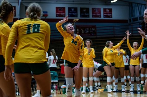 PUSHING FORWARD—Freshman setter Caylie Barlage celebrates a point for NMU last weekend in the Indianapolis Tournament. She had a lot more playing time than expected due to the injury of junior setter Lauren Van Remortel. The