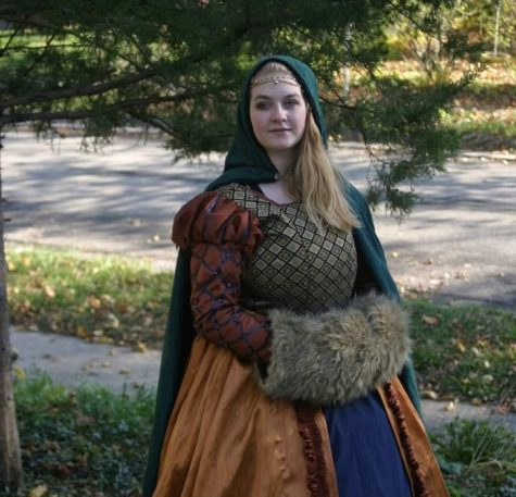 Amelia Rhinerson made this costume for her Madrigal choir performances, but she never got to wear it due to COVID-19. She has since made many more outfits by hand and has started her own business, Madrigal Threads.