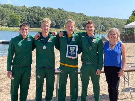 COMING BACK CHAMPS—The NMU Mens Swim and Dive team won the CSCAA Open Water Nationals in Lawrence, Kansas this past weekend. Pictured is the winning team Grant Combs, Jasper Pullinen, Ondrej Zach and Thibault Auger. due to a lack of lifeguards