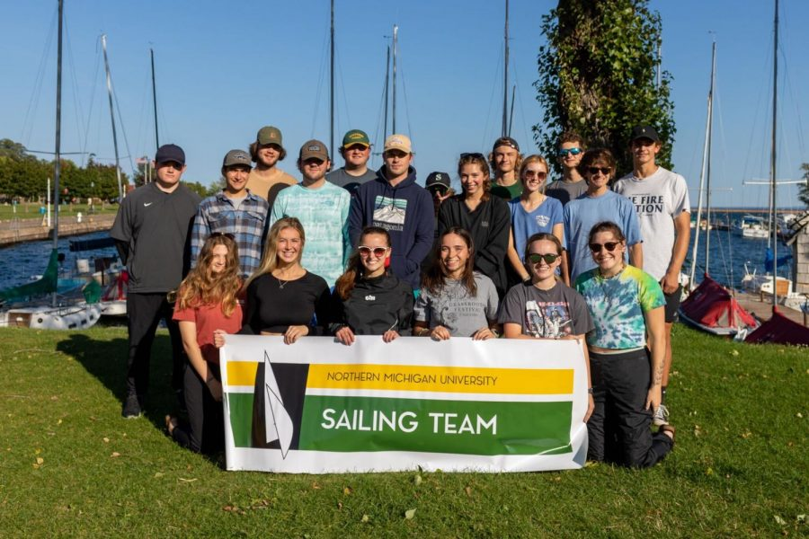 GALES OF SEPTEMBER—The NMU Sailing team poses for a picture. Even when temperatures dip and the wind picks up, you can find the sailors navigating the waters of Lake Superior. Photo courtesy of Kenadee Torres.