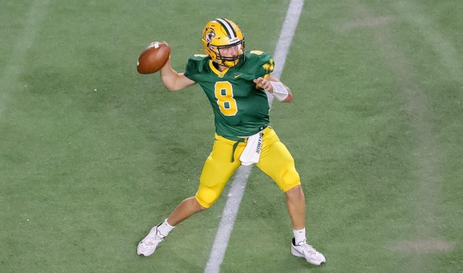 TOUGH BLOW—NMU quarterback Drake Davis drops back to pass during Saturdays 21-14 loss to Michigan Tech. The Wildcats have now lost 11 straight meetings against the Huskies dating back to 2010. Photo courtesy of NMU Athletics.