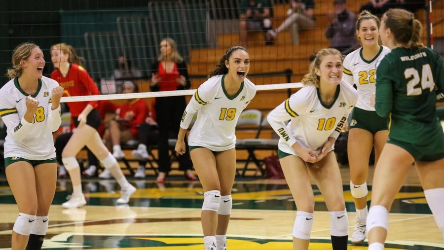 TRYING TO BEAT YOUR RIVAL—The NMU volleyball team celebrates a point against Ferris State on Friday, Sept. 17.  The newest edition of the U.P.s biggest rivalry between NMU and MTU will commence on Saturday inside of Vandament Arena. Photo courtesy of NMU Athletics.