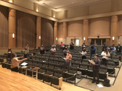 SOCIAL DISTANCED SINGING — Choir students rehearse six feet apart during the height of the COVID-19 pandemic. Now the choirs are able to perform on stage together, but still wear masks as much as possible.