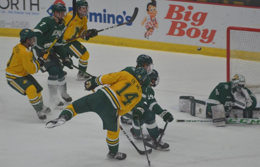 SWEPT AT HOME—NMU forward Vincent de Meys shot sails wide left of the net during Saturdays 4-3 loss to Bemidji State. The Beavers also won Fridays match-up 5-4, sweeping the Wildcats in the process. Travis Nelson/NW