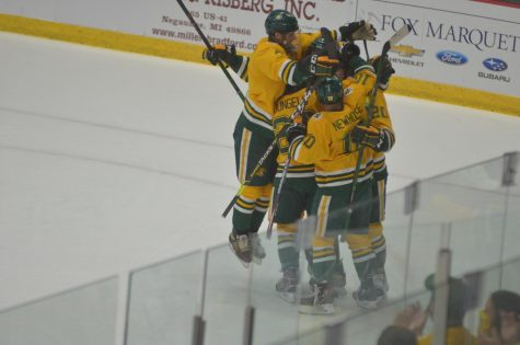 SWEET, SWEET SWEEP—The team celebrates after forward Connor Marritts first career goal put NMU in front 2-1 in the first period of Saturdays win over St. Thomas. The Cats averaged six goals per game on the weekend, and are looking good to start the season. Travis Nelson/NW
