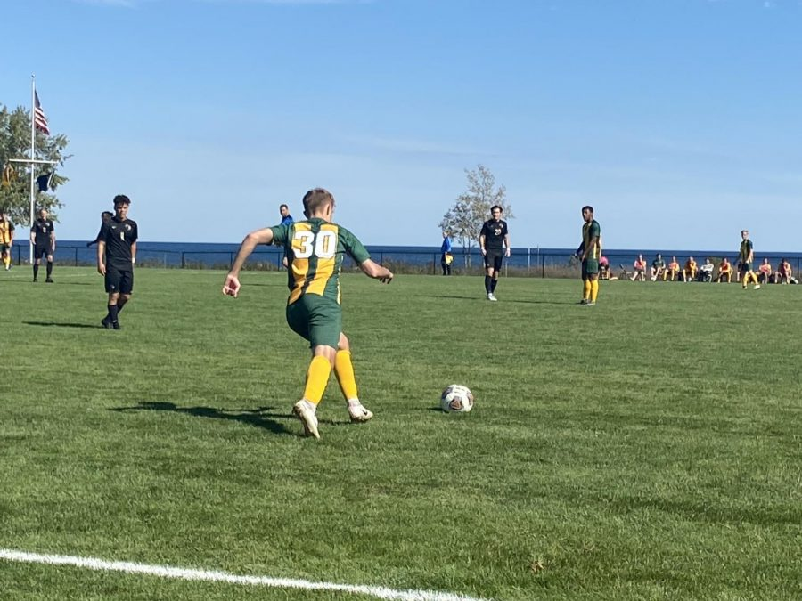 AVENGING LOSSES—NMU freshman midfielder Dominik Vyleta goes to kick the ball during the Wildcats 1-0 win over Purdue Northwest on Friday, Sept. 24. NMU now shifts it focus to a road match with UW-Parkside on Sunday after losing two matches last weekend. Travis Nelson/NW