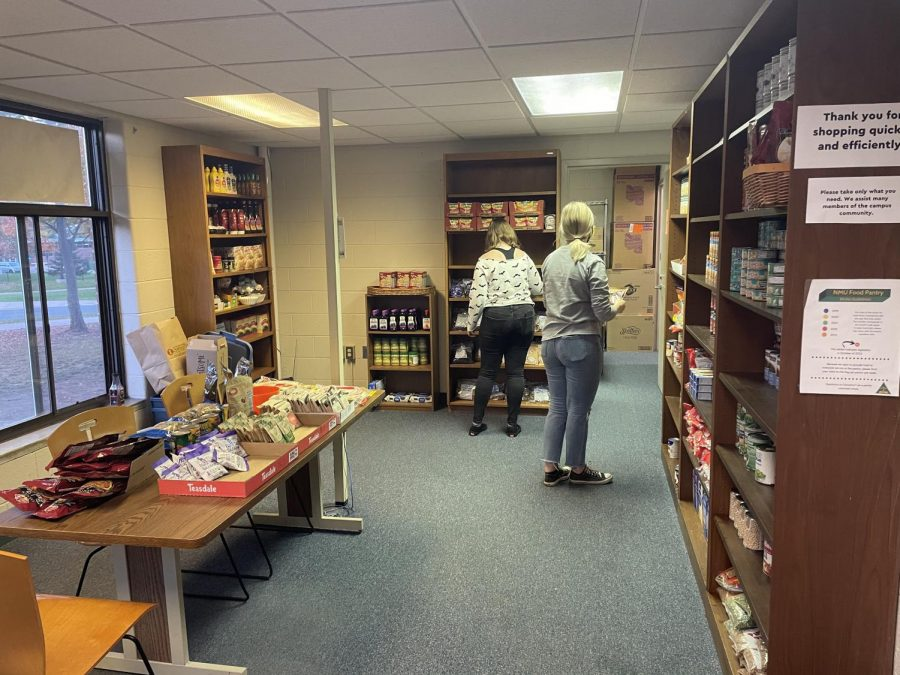 Interns Sarah Huiber and Mandy Helppi (left to right) help restock the shelves in the NMU Food Pantry. The food pantry is open to any student, faculty or staff member that may require extra assistance getting food or personal items.