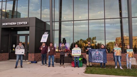 TAKE A STAND—Students, professors and community members gathered in front of the Northern Center on Oct. 19 to protest Enbridges harmful Line 5. The protest was organized in part by NMU professor Martin Reinhardt.